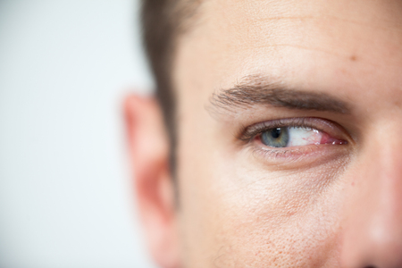Close-up of man wearing contact lens Stock Photo
