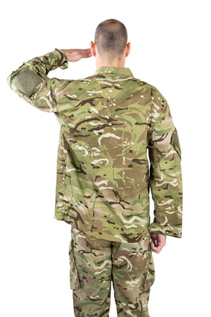 Rear view of soldier saluting on white background Stock Photo