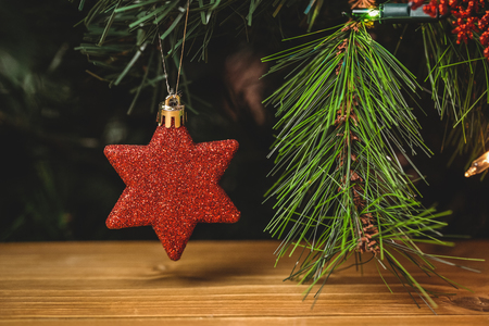 fake christmas tree: Close-up of christmas star hanging on christmas tree during christmas time Stock Photo