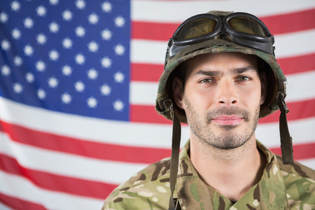 militant: Close-up of confident soldier against american flag