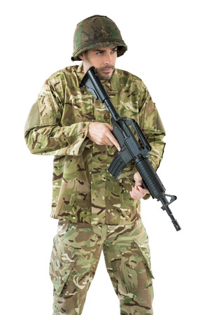 militant: Soldier holding a rifle against white background