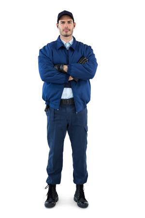guardaespaldas: Retrato de seguridad de pie con los brazos cruzados contra el fondo blanco Foto de archivo