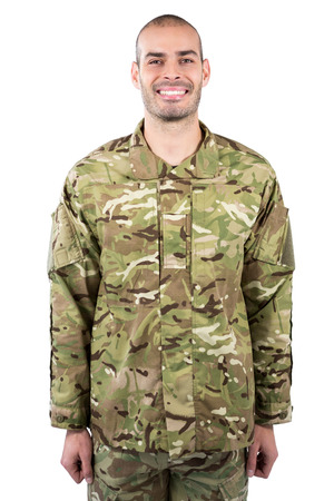 militant: Portrait of smiling soldier standing against white background