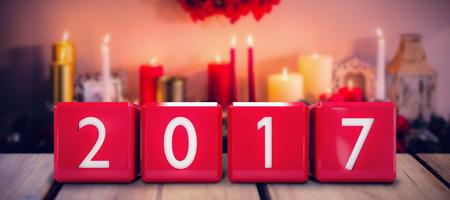 apartment bell: Cubes with numbers against candles and christmas decorations arranged on fireplace Stock Photo