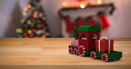 domicile: Miniature train against defocused of christmas tree lights and fireplace