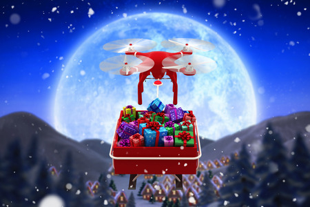 Digitally generated image of  flying drone pulling Chirstmas sledge against christmas village under full moon Stock Photo