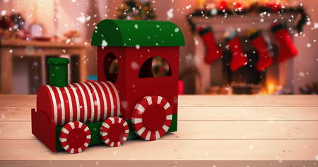 steam engine: Steam engine with white and red striped against christmas tree with presents near fireplace