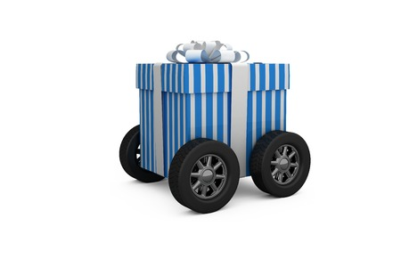 digitally generated image: Digitally generated image of gift box with wheels against white background