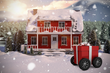 wrapped: Gift box wrapped in red paper with ribbon on wheels against red house with trees