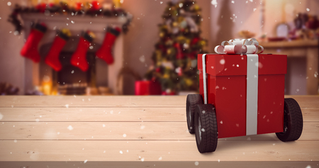 apartment bell: Red gift box on wheels against christmas tree with presents near fireplace