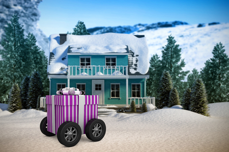 Gift on wheels against three dimensional house snow covered Stock Photo