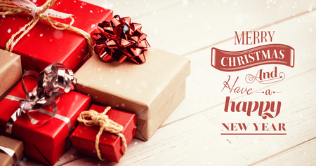 Merry Christmas message against high angle view of gift boxes