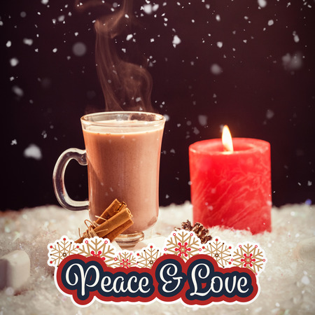 Peaceful message against hot chocolate and candle on fake snow