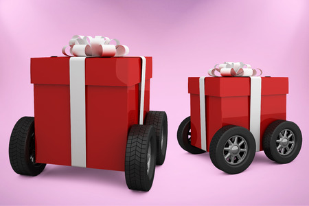 red gift box: Red gift box on wheels against pink background