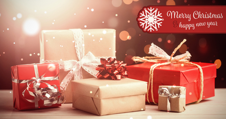 composite image: Banner Merry Christmas against composite image of presents on table
