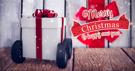 wooden plank: Christmas card against red ribbon tied on wooden plank Stock Photo