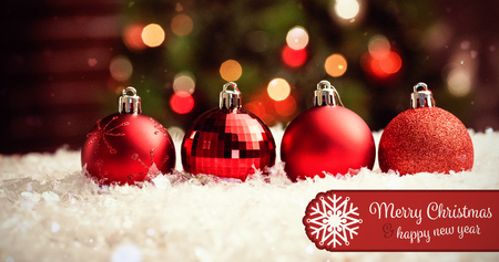 Banner Merry Christmas against various type of christmas baubles on snow