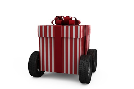 plain background: Striped red and white gift box on wheels against plain background
