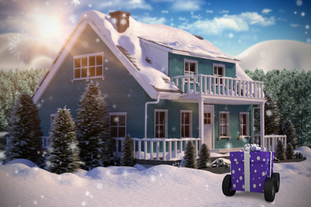 snowcapped mountain: Gift box with gray ribbon on wheels  against three dimensional house