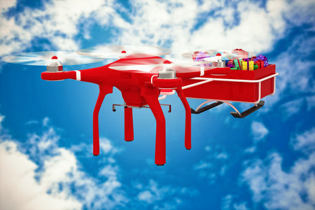 pulling beautiful: Flying drone pulling Chirstmas sledge against view of beautiful sky and clouds Stock Photo