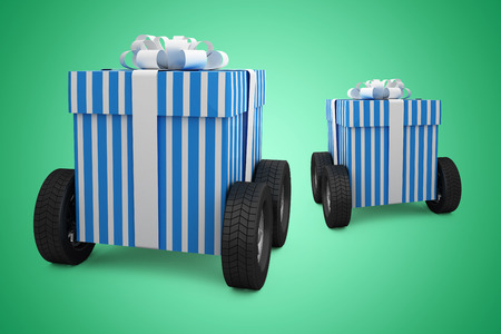 Blue and white striped gift box on wheels against green vignette