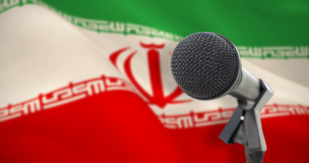 Microphone with stand against digitally generated iranian national flag Stock Photo