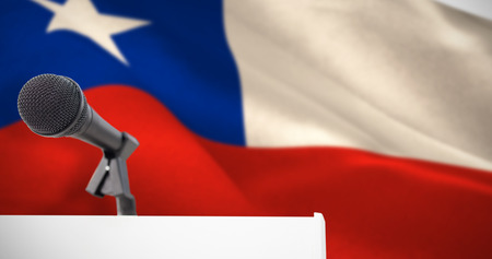 Microphone on podium against digitally generated chile national flag Stock Photo