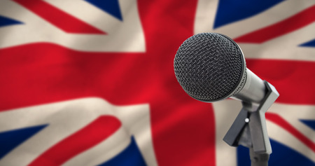 Microphone with stand against digitally generated great britain national flag