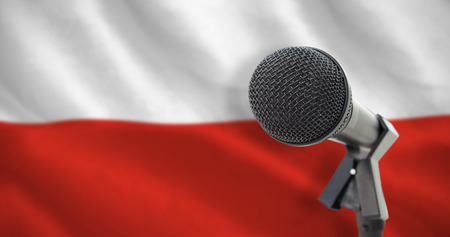 bandera de polonia: Microphone with stand against digitally generated polish flag rippling Foto de archivo