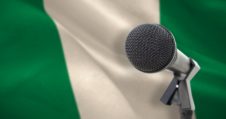 Microphone with stand against digitally generated nigerian national flag