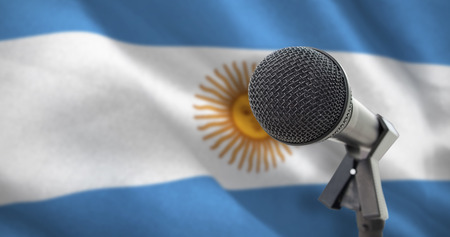 Microphone with stand against digitally generated argentinian national flag