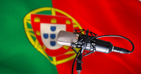 portugese: Condenser microphone against digitally generated portugese national flag Stock Photo