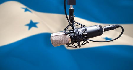 Condenser microphone against digitally generated honduran national flag Stock Photo