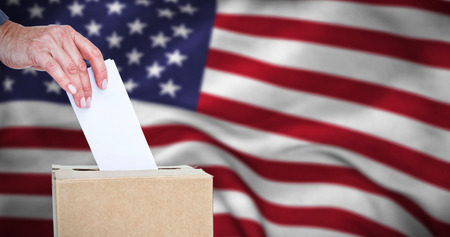 usa flags: Close-up of businesswoman putting ballot in vote box against american flag