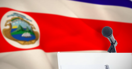 Microphone with stand on podium against costa rica national flag Stock Photo
