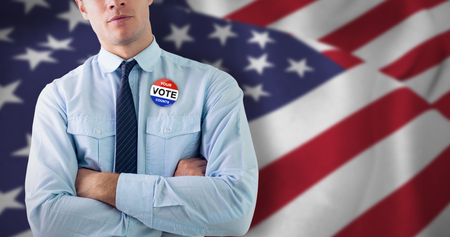 Elegant businessman with arms crossed in office against close up of the us flag
