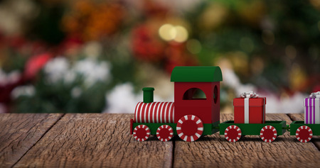 domicile: Train set with gift boxes against two snowman with fake snow