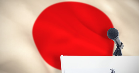 criss cross: Microphone with stand on podium against digitally generated japanese national flag Stock Photo