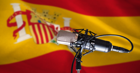 condenser: Condenser microphone against digitally generated spanish national flag
