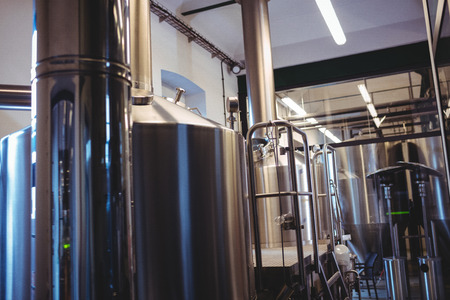 brewery: Industrial equipment at illuminated brewery