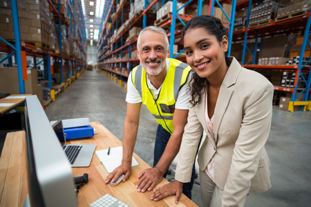 Portrait of warehouse manager and worker working together in warehouse office Stok Fotoğraf