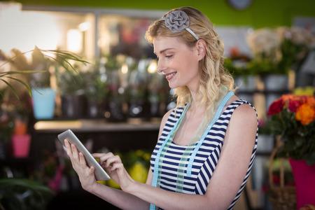Female florist using digital tablet in the flower shop Stock Photo