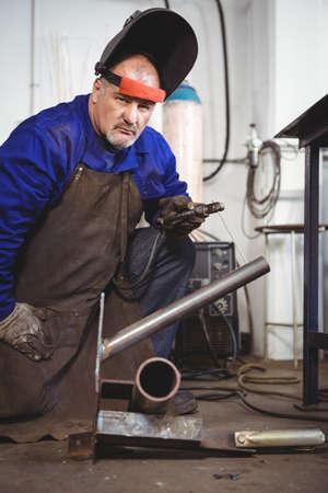 welding machine: Portrait of welder with welding machine in workshop LANG_EVOIMAGES
