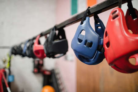 Close-up of various headgear hanging in fitness studio