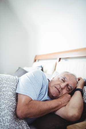 ageing process: Senior man sleeping on bed at bedroom Stock Photo