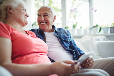 ageing process: Senior couple sitting together at home