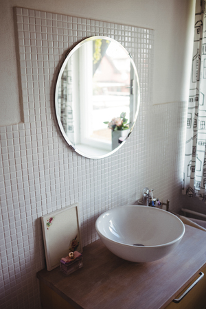 wash basin: View of wash basin and mirror at bathroom Stock Photo