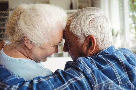 ageing process: Senior couple embracing each other at home