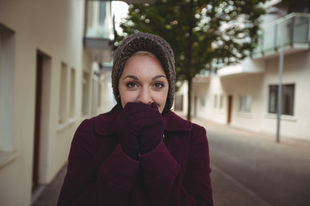 shivering: Woman shivering with cold in street