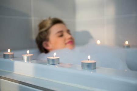 woman bath: Woman taking bath in bathtub at bathroom
